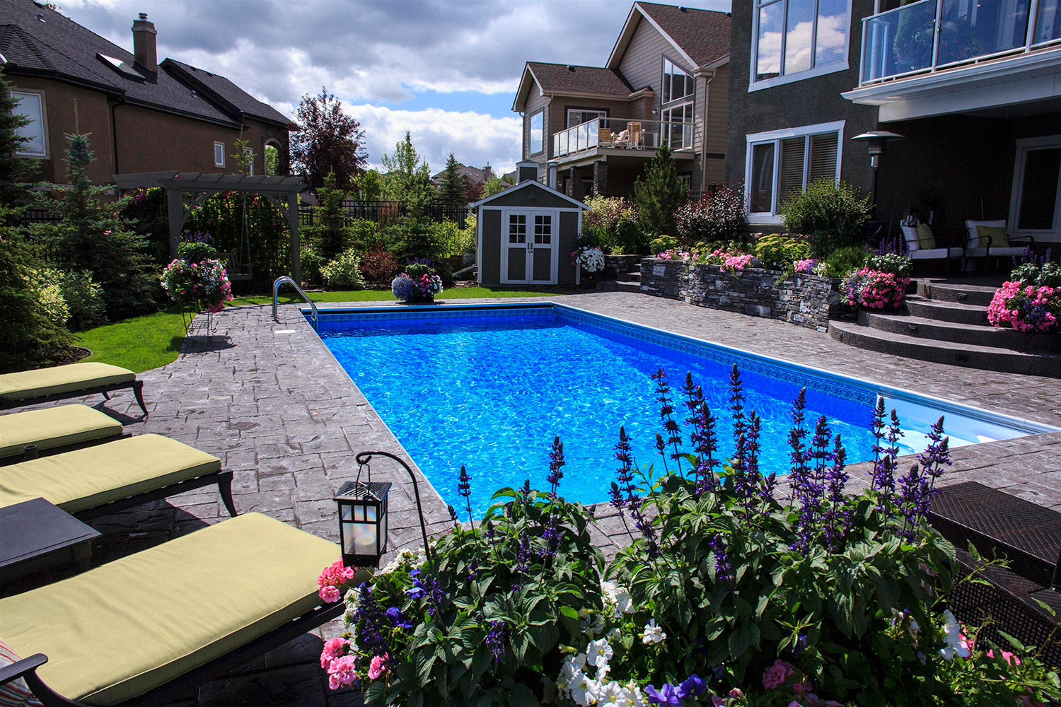 Inground pools and backyard spas are becoming popular landscaping features to add to your Calgary yard.