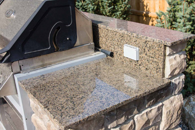 Add granite countertops to your outdoor kitchen space