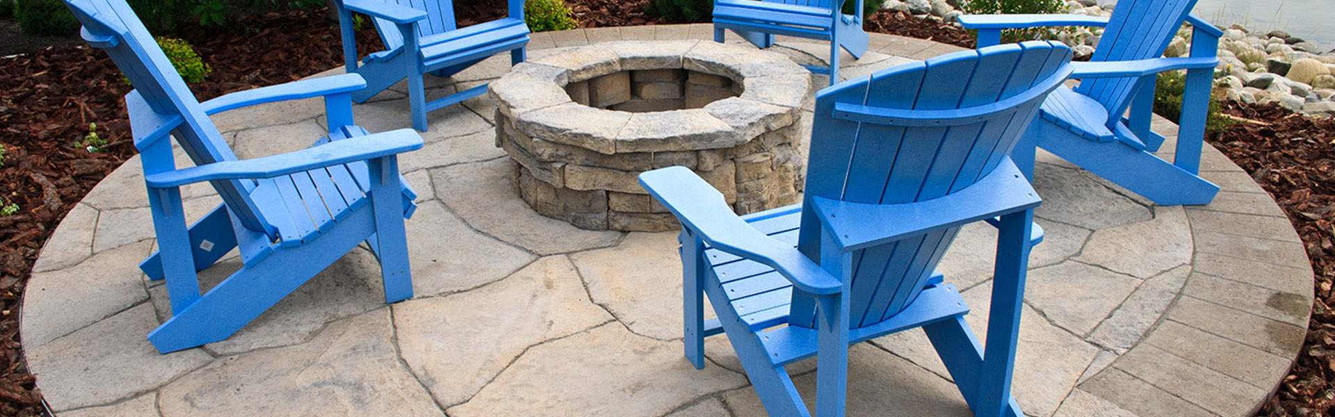Backyard patios can be made from stamped concrete or a selection of pavers.