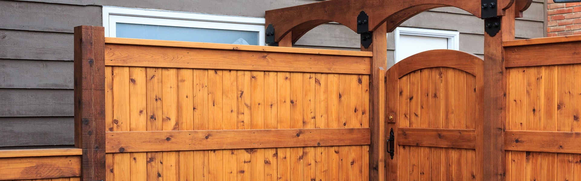 Wood fences and gates frame your backyard landscaping
