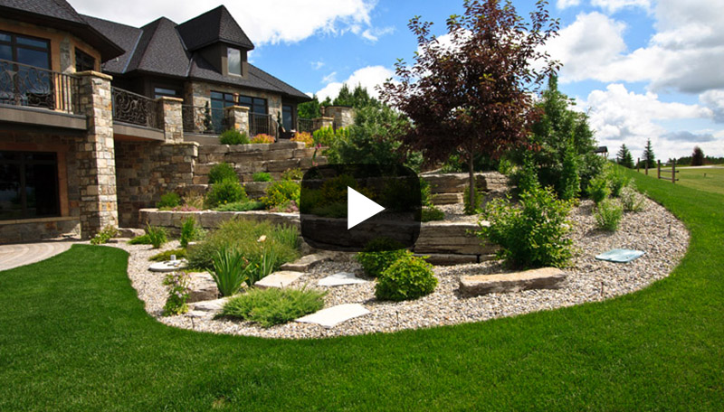 This NW Calgary acreage required large retaining stone to frame the large spaces as well as security gates and a childrens play area