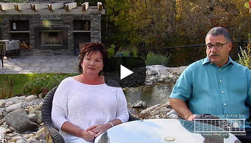 Customer testimonial with a large estate landscaped yard with stream, pond, outdoor kitchen and more